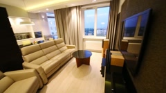Modern living room with a comfortable sofa and armchairs and a TV Stock Footage