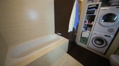Modern bathroom with toilet, washing machine and bathtub Stock Footage
