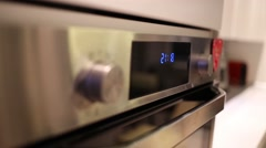 Digital clock show time 21.18 and 21.19 on the stove Stock Footage