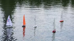 Miniature radio-controlled sailboats on the pond surface Stock Footage