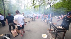 Specially equipped area in park with people roasting barbecues Stock Footage