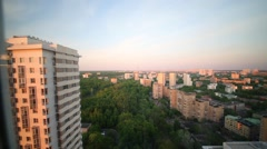 View of the evening city from a living room window Stock Footage