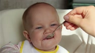 Mum feeds the child with a spoon of porridge Stock Footage