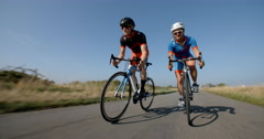 Male and Female Cycling on Sunny Day. Stock Footage