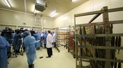 Shelves with fish and reporters interviewing of Alexey Nemeryuk Stock Footage