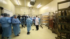 A spacious hall filled with reporters interviewing Alexey Nemeryuk Stock Footage