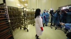 Reporters interviewing woman at plant Russian fish factory Arkistovideo