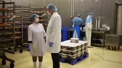 Workers in the shop for packaging fish at plant Russian fish factory Stock Footage
