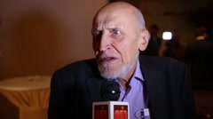 Scientist and TV presenter Nikolai Drozdov gives interviews Stock Footage