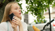 Girl explaining someone the way while talking on cellphone Stock Footage