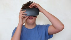 Boy turns wheel of settings on the virtual reality glasses Stock Footage