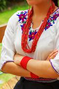Closeup beautiful hispanic woman wearing traditional andean white blouse with Stock Photos