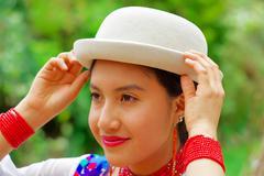 Headshot beautiful hispanic woman wearing, hat, traditional andean white blouse Stock Photos