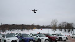 Drone flies above car on parking at winter day Stock Footage