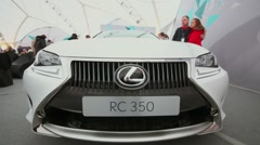 Lexus RC 350 in exhibition pavilion with people Stock Footage