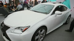 People watch on Lexus RC 350 during exhibition Stock Footage