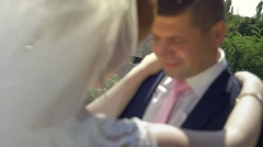 Young wedding couple enjoying romantic moments outside on a summer meadow Stock Footage