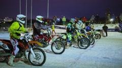 Bikers start ride during motocross race in Krylatskoe at winter evening Stock Footage