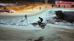 Motorcyclists jump during race on motordrome in Krylatskoe Stock Footage