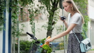 Girl doing photo of her shopping in the basket on the antique camera Stock Footage