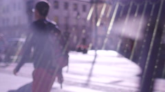 Anonymous people walk in city in slow motion Stock Footage