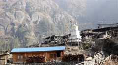 Village in Himalaya with Buddhist stupa Stock Footage
