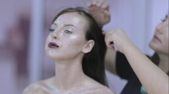 Make-up artist doing make-up girl Stock Footage