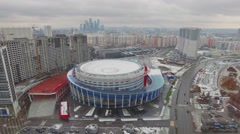 City traffic near edifice of sports complex Megasport at cloudy day Stock Footage