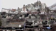 Stone houses under the rocks of Himalayas Stock Footage