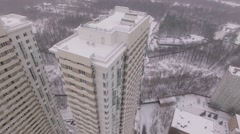 Facade of multilevel houses on Elk Island at winter day. Aerial view Arkistovideo