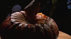 Cutting Halloween Pumpkin Top Part With Knife Stock Footage