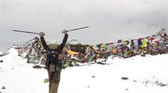 Woman reaches the top of the Himalayan mountain Stock Footage