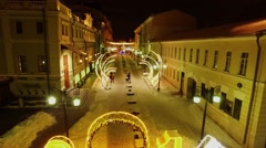 Adorned street with illuminated gate in shape of 2016 number near houses Stock Footage