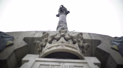 Santa Fe coat-of-arms on Columbus Monument plinth at bottom of tall column Stock Footage