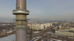 Ostankinskaya TV tower against cityscape with street traffic Stock Footage