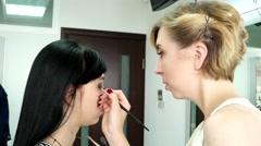 Makeup, hair, hair straightening hair iron, applying eye shadow, eye preparation Stock Footage