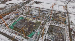 Panorama of construction site with many cranes on territory of factory Stock Footage