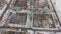 Building site with many cranes at winter day. Aerial view Stock Footage