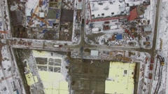 Several cranes work on construction site at winter day. Aerial view Stock Footage