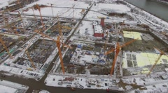Building site with many cranes on territory of ZIL factory at winter day Stock Footage