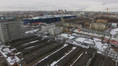 Cityscape with buildings of ZIL factory and street traffic at winter day Stock Footage