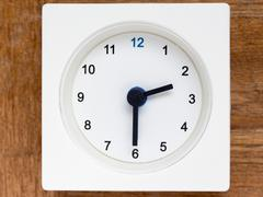 Series of the sequence of time on the simple white analog clock , 11/48 Stock Photos