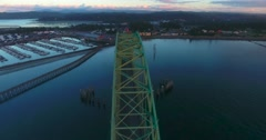 Flying over a coastal bridge at sunset (Newport, OR) Stock Footage