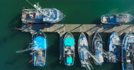 Slow top-down pan shot of boats at a dock in Newport, OR Stock Footage