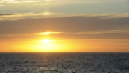 Sunset over the ocean in timelapse. The Sun glows strongly, then disappears. Stock Footage