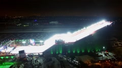 Stadium for Freestyle World Cup at winter evening. Aerial view Stock Footage