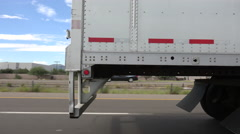 4K Passing Semi Truck On Busy Highway Close Up Stock Footage