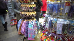 Variety of colorful token gifts at souvenir shop for tourists to remember trip Stock Footage