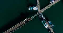 Spiraling aerial shot of boats at a dock Stock Footage