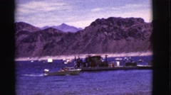 1968: a small metal motor boat traveling in the water towards the shoreline Stock Footage
